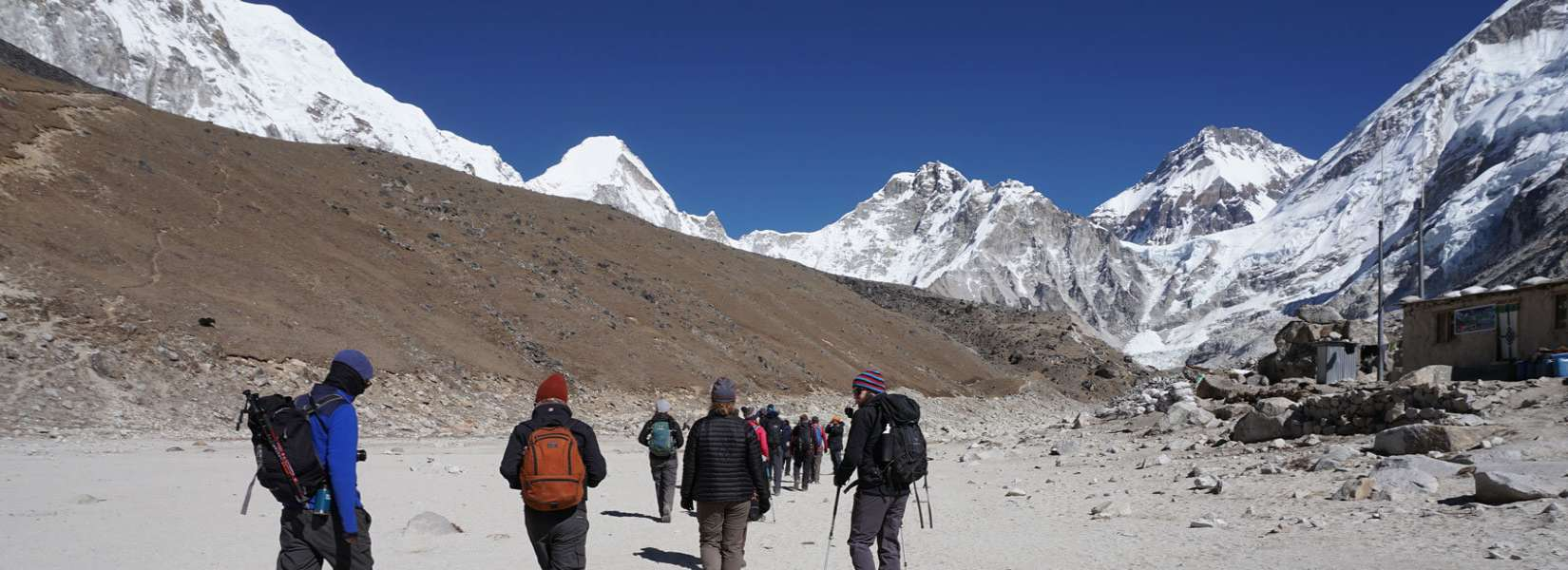 Trekkers walking towards Everest Base Camp