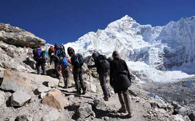 Trekkers heading to EBC while doing Everest High Passes and Peaks