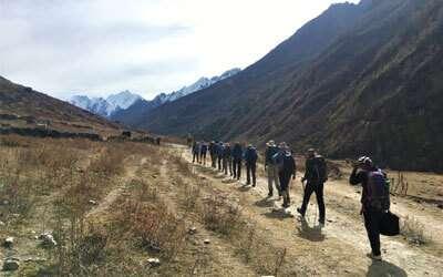 Trekkers walking in the valley of Langtang